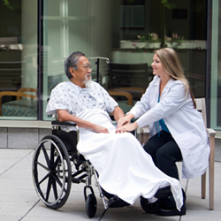Doctor Attending to Patient in a Wheelchair